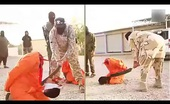 ISIS beheading imprisoned men