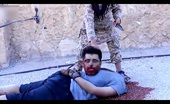 ISIS child militant beheading Syrian soldier
