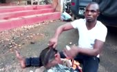 African Man Shows His Wife Decapitated Head