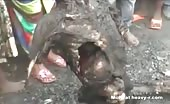 African tribe girl eating raw rotten human corpse