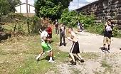 School boys street fighting