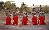 ISIS Children executing prisoners