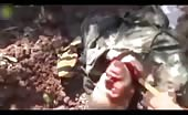 Using a hand saw to behead a dead Syrian soldier