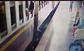 India - A Man Trying To Get Off The Train In Motion