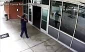 Crazy Guy With Bat At Police Station
