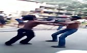 Indian drunk man fighting in street.